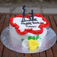 This Single Deck White Fondant Cake With Roses and red ribbon border is specially baked for a wedding, anniversary and as well as for birthday parties. This cake taste as great as this look. To add to the design it has a couple shaped chocolate at the top. FREE HOME DELIVERY. See more wedding cakes and shop online for cakes in Nepal from your trusted online shopping site in Nepal.   All cakes are baked with hygiene and quality in the top of our priority at our own state-of-the-art baking facility and quality checked twice by our expert QC team before delivery. You can send cakes or gifts to your loved ones in Nepal or shop online for yourself in Nepal with UG Bazaar, a pioneer in online shopping in Nepal.