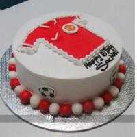 Make your special one's more surprise with this single deck cake with Manchester United jersey printed on the top. To add more to design red and white bead are place at the base around the cake. You choose your favorite football club, we will bake your favorite one with your own favorite flavor and design. FREE HOME DELIVERY*.   All cakes are baked with hygiene and quality in the top of our priority at our own state-of-the-art baking facility and quality checked twice by our expert QC team before delivery. You can send cakes or gifts to your loved ones in Nepal or shop online for yourself in Nepal with UG Bazaar, a pioneer in online shopping in Nepal.