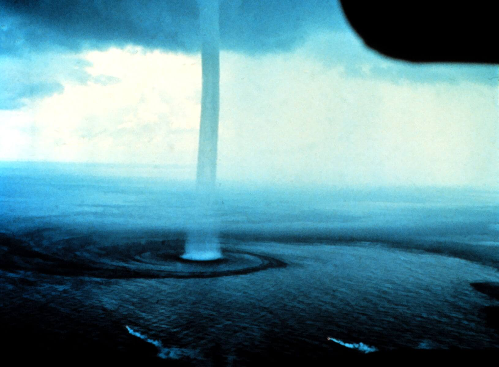 The circular motion of the wind in a tornadic waterspout. Image Source: Wikimedia Commons