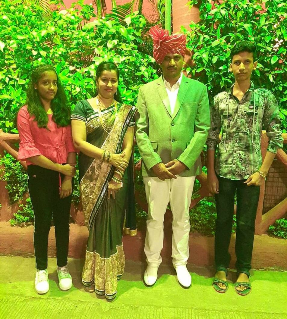District topper Rounik with his family